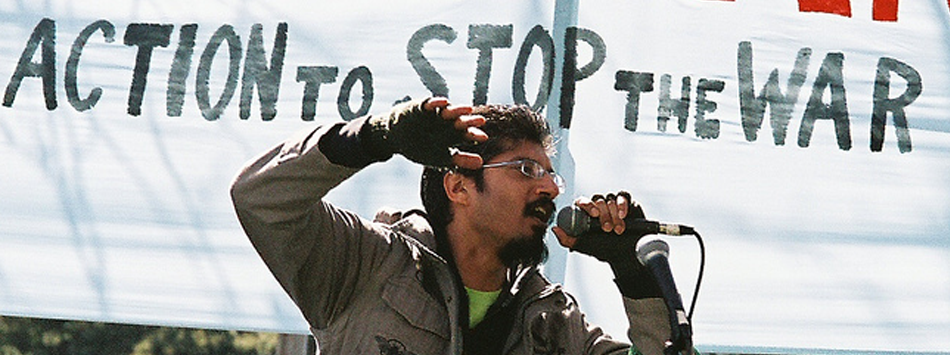 shahid rhyming on a flatbed truck to stop the war in iraq